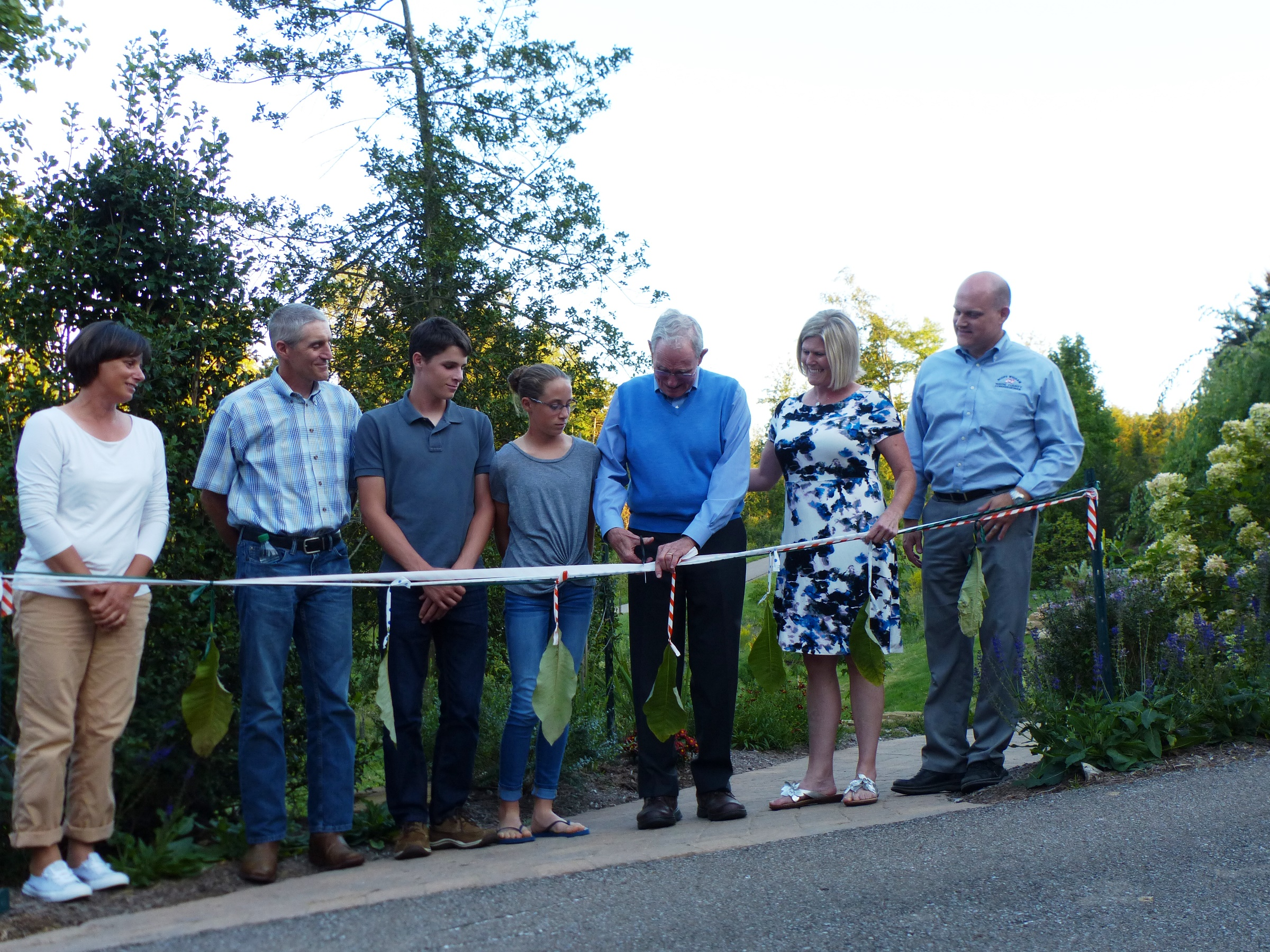 Ken's Magnolia Grove ribbon cutting begins