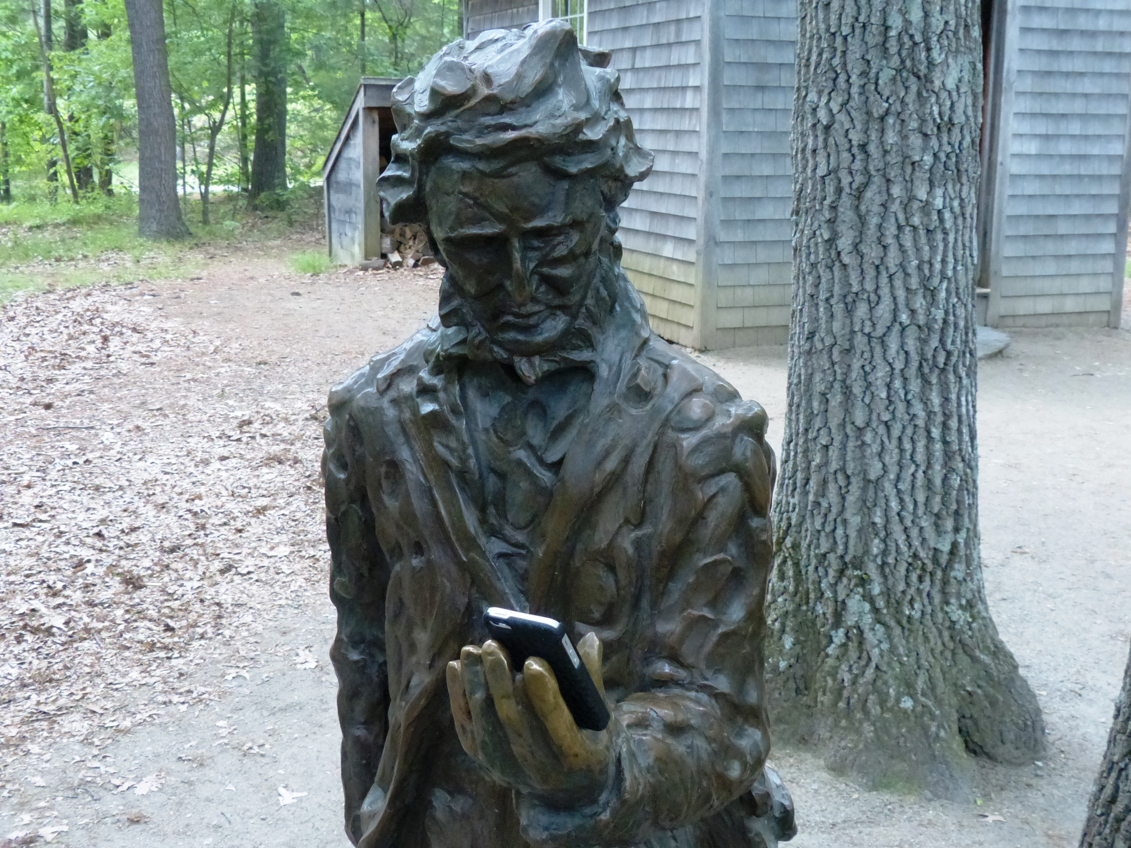Thoreau statue with cell phone